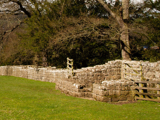 Which major Hadrian's Wall fort lies across the valley from Brunton Turret?