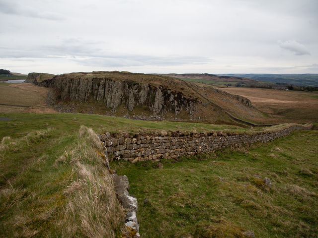 The spectacular view of Hadrian's Wall from Steel Rigg includes which lough (lake)?