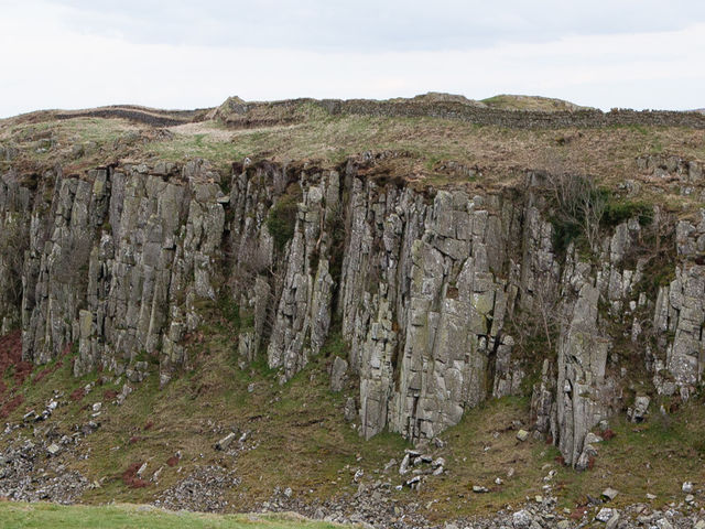 Much of the stone for Hadrian's Wall came from a local geographical feature. What is this feature called?