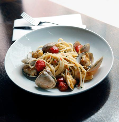 Spaghetti fresca with clams and smoked tomatoes