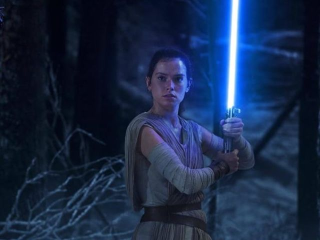 "Who does Rey inherit a lightsaber from in ""The Force Awakens""?"
