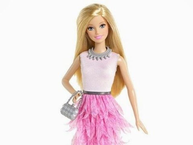 As of 2015, what shoes can Barbie finally wear?