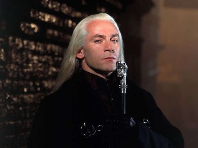 Admittedly, it might look a little like Gandalf minus the hat, but Gandalf isn't part of this franchise, so it's Lucius Malfoy.