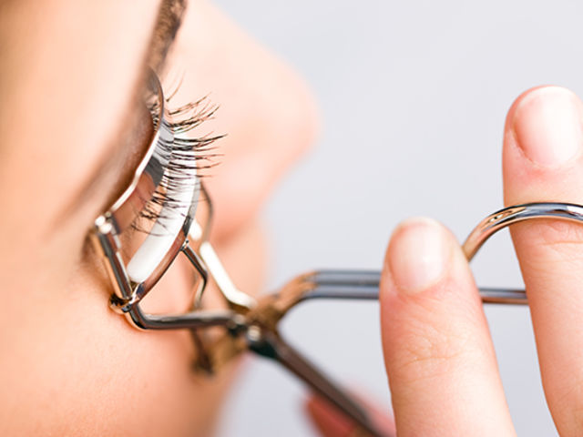 This is an Eyelash Curler! People use it to curl their eyelashes, which are then held in place with mascara!