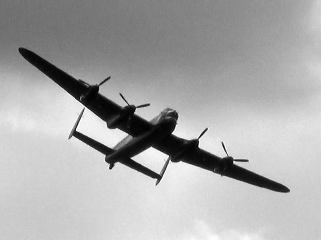 This classic WWII bomber flying over Bourn is a...