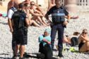 French Police Just Forced A Sunbathing Woman To Remove Her Burkini On A Beach In France
