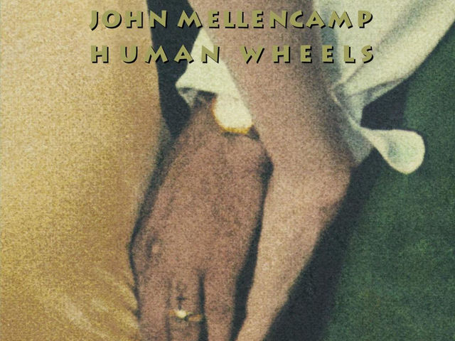 "During the making of ""Human Wheels"", one of John's band members died of a heart attack. Who was it?"